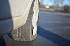 """Getting a Flat Tire"" Some rights reserved (CC BY-NC 2.0) by Michael Kappel. Sourced from Flickr"