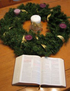 Unlit Candles in Advent wreath with Bible