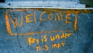 Chalked Message: Welcome: Key is under mat
