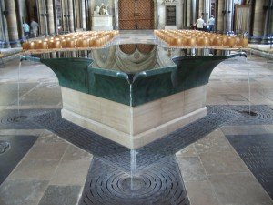The striking, cross-shaped green marble font of Salisbury Cathedral